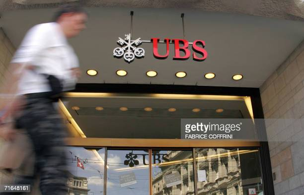 A man walks in front of the entrance of the UBS headquarters 15 August 2006 in Zurich Switzerland's largest bank UBS reports a 47percent rise in...