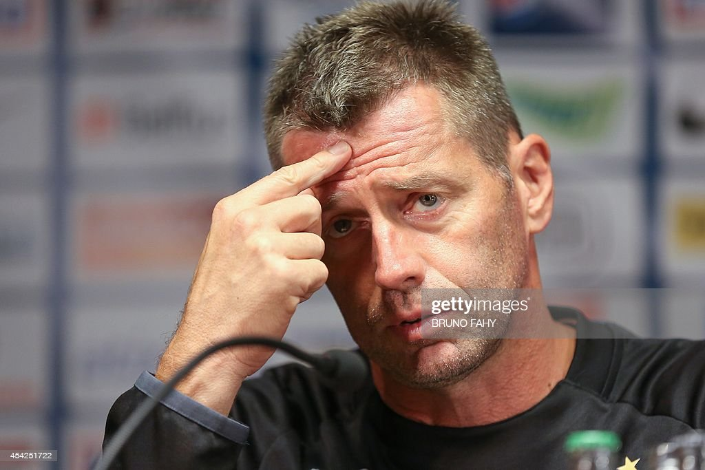 Zurich's German head coach Michael Skibbe gives a press conference of Swiss team Grasshoppers Zurich on August 27, 2014 in Brugge, on the eve of the UEFA Europa League playoff football match betwee...