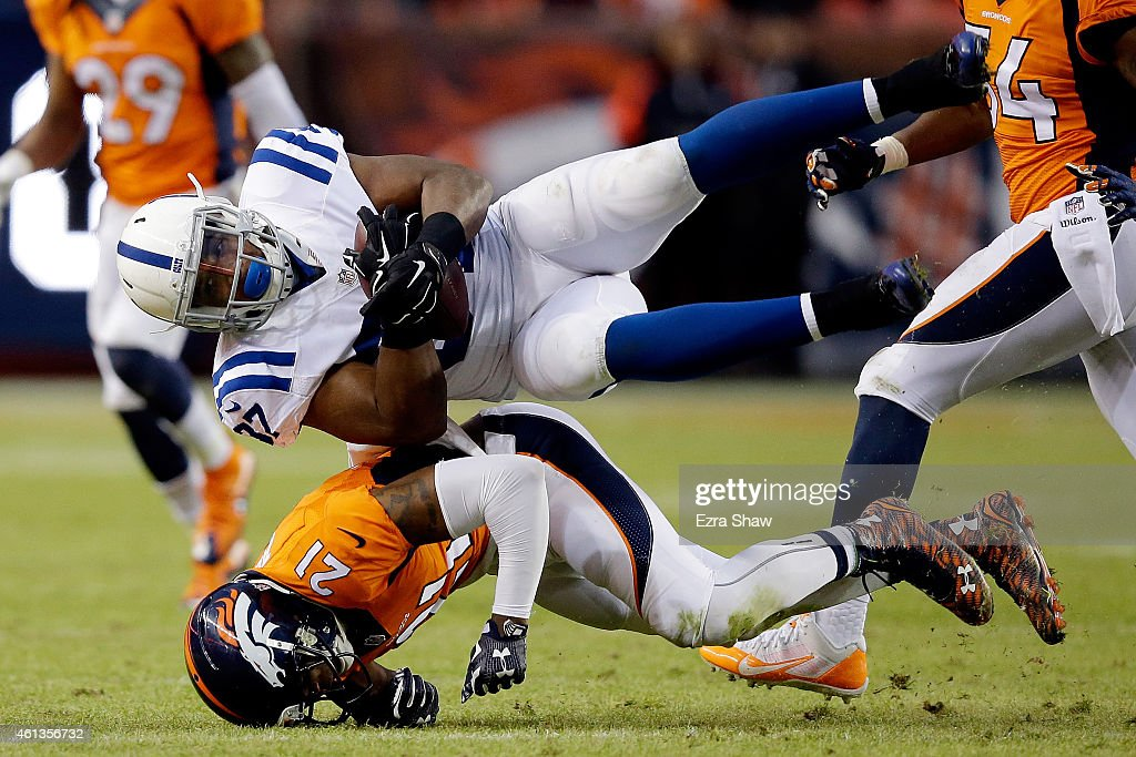 Zurlon Tipton #37 of the Indianapolis Colts comes down with a catch onto the body of Aqib Talib #21 of the Denver Broncos during a 2015 AFC Divisional Playoff game at Sports Authority Field at Mile High on January 11, 2015 in Denver, Colorado.