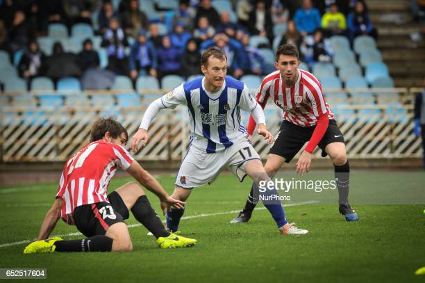 Zurutuza of Real Sociedad duels for the ball with Muniain and Yeray ¡lvarez of Athletic Club during the Spanish league football match between Real...