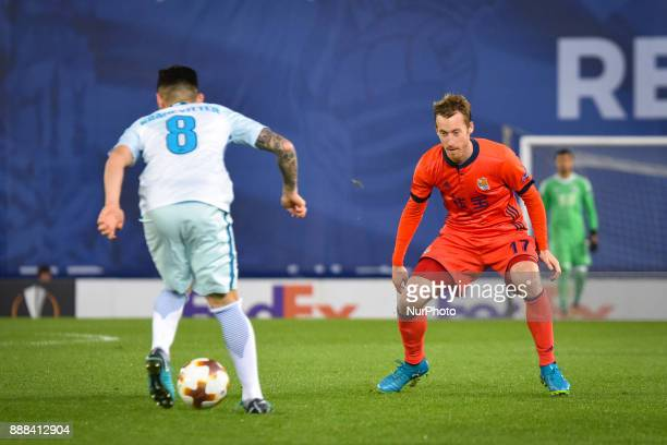 Zurutuza of Real Sociedad vies with Matias Kranevitter of Zenit during the UEFA Europa League Group L football match between Real Sociedad and Zenit...
