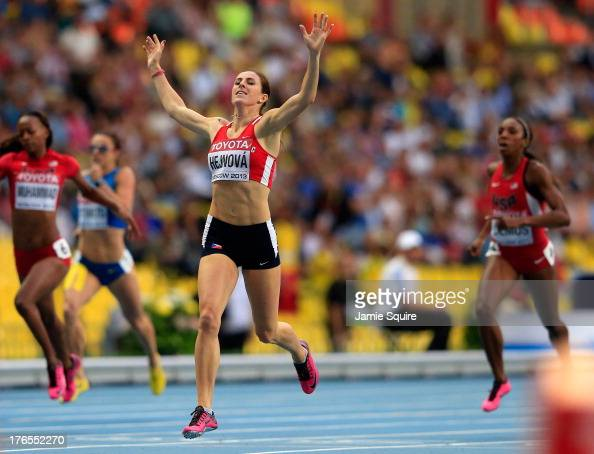 Zuzana Hejnova of the Czech Republic crosses the line to win gold the Women's 400 metres hurdles final during Day Six of the 14th IAAF World...