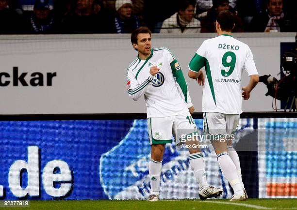 Zvjezdan Misimovic of Wolfsburg celebrates his team's first goal with team mate Edin Dzeko during the Bundesliga match between 1899 Hoffenheim and...