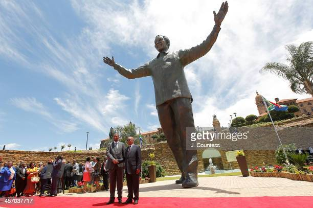Zwelivelile 'Mandla' Mandela and South African President Jacob Zuma pose for a photo in front of a statue of former South African president Nelson...