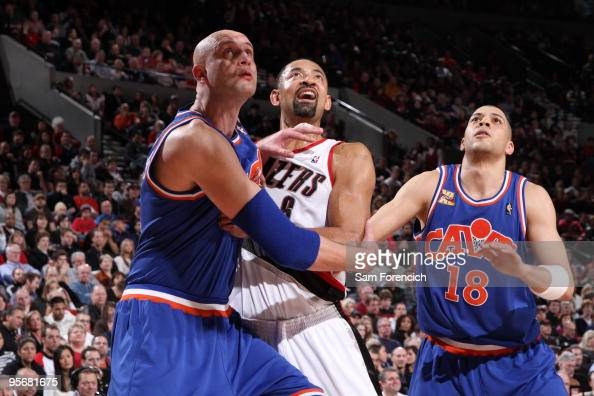 Zydrunas Ilgauskas and Anthony Parker of the Cleveland Cavaliers block out Juwan Howard of the Portland Trail Blazers during a game on January 10...