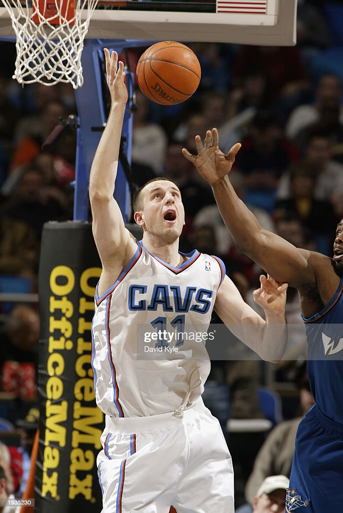 Zydrunas Ilgauskas #11 of the Cleveland Cavaliers attempts to block a shot during the game against the Washington Wizards at the Gund Arena on April 8, 2003 in Cleveland, Ohio. The Wizards won 100-91.