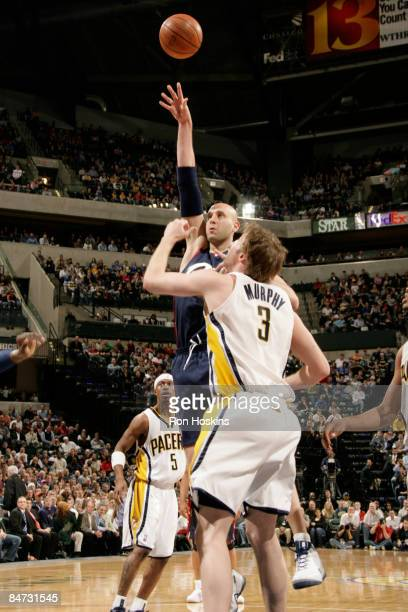 Zydrunas Ilgauskas of the Cleveland Cavaliers shoots over Troy Murphy of the Indiana Pacers at Conseco Fieldhouse on February 10 2009 in Indianapolis...