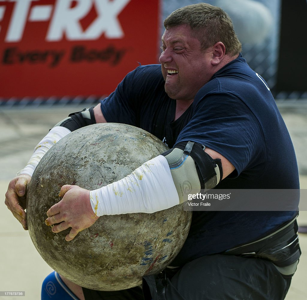 Zydrunas Savickas of Lithuania competes at the Atlas Stones event during the World's Strongest Man competition at Yalong Bay Cultural Square on August 24, 2013 in Hainan Island, China.