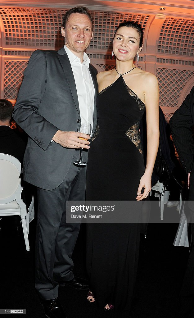 Zygi Kamasa (L) and Joanne Black attend the IWC and Finch's Quarterly Review Annual Filmmakers Dinner at Hotel Du Cap-Eden Roc on May 21, 2012 in Antibes, France.