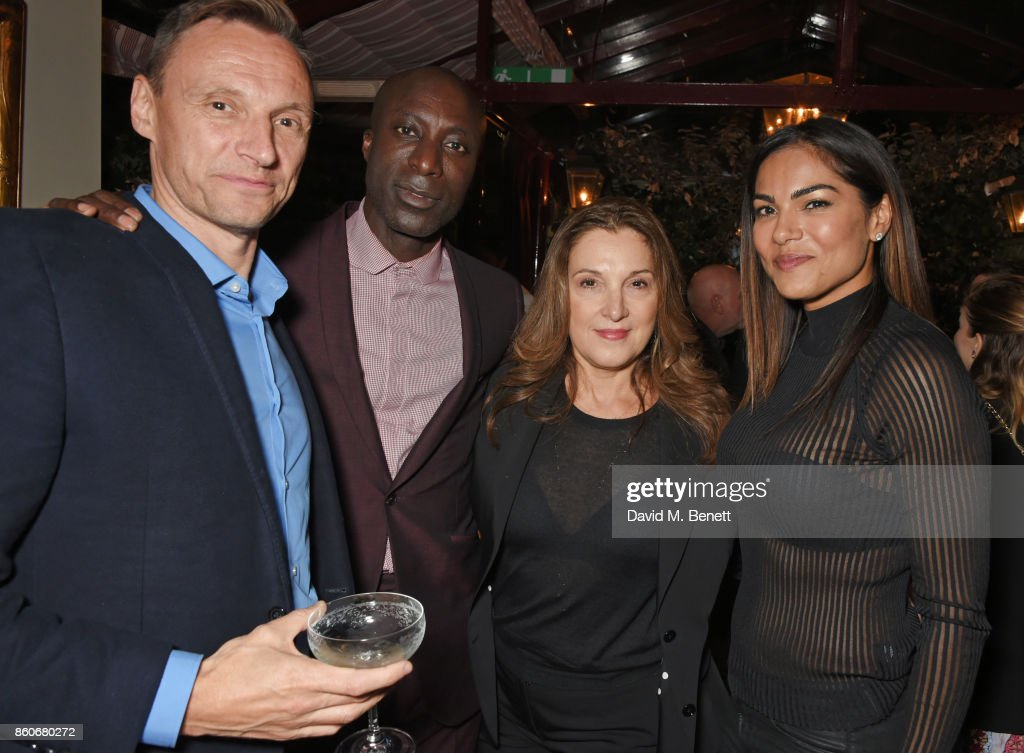 Zygi Kamasa, CEO of Lionsgate UK, Ozwald Boateng, co-producer Barbara Broccoli and guest attend the PORTER & Lionsgate UK after party for 'Film Stars Don't Die In Liverpool' at Mark's Club on October 12, 2017 in London, England.