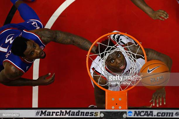 Zylan Cheatham of the San Diego State Aztecs and Jamari Traylor of the Kansas Jayhawks battle for rebound during the second half of a game at Viejas...