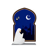 muslim woman prayer at night with mosque background