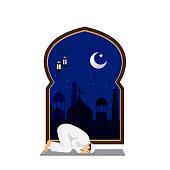 muslim man prayer at night with mosque background