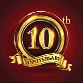 Celebrating 10th golden anniversary, ten years birthday logo celebration with gold ring and golden ribbon.