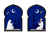 muslim man and woman prayer at night with mosque background