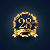 28th anniversary celebration badge label in golden color
