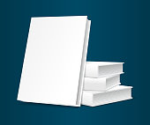 Book templates. Four pieces in a pile, three are, the fourth leaning against them. Blank cover white color for inserting images. Isolated, on a blue uniform background.
