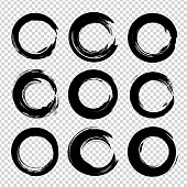 Abstract black textured nine circle smears set isolated on a white background