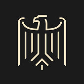 Abstract stylized eagle like coat of arms of Germany. Minimal modern symbol on black background.