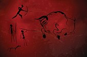 Abstract primitive art - stylized drawing of prehistoric hunters and bull. Vector illustration.