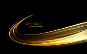 Abstract shiny color gold wave design element on dark background.