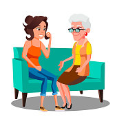 Adult Woman Talking To Her Mature Mother On The Couch Vector. Illustration