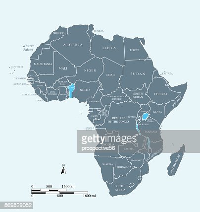 Africa map vector outline illustration with miles and kilometers scales and countries names labeled in blue background : stock vector