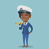 Young african-american airline pilot holding the model of airplane in hand. Female airline pilot wearing uniform and playing with the model of airplane. Vector cartoon illustration. Square layout.
