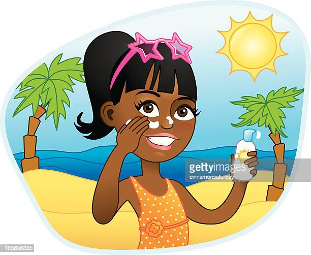 African american girl applying sunscreen