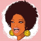 happy smiling African-American woman with hair in disco style with earrings on a pink background