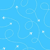 Airplanes with traces background. Seamless aerial pattern