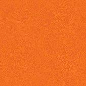 Seamless background made of paisley. Vivid orange.