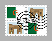 Algerian flag and timgad on postage stamps