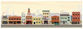 An illustrated depiction of shops, restaurants, stores and businesses along a main street in rural America. The scene in set in early fall with cool morning air, smoke stacks, church, water tower and