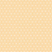 An abstract geometric background or pattern that is made up of hexagons of different sizes. Modern texture in orange