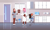 arab doctor and nurse examining x-ray hospital workers looking patient radiography cartoon characters full length medicine healthcare concept hospital clinic office interior vector illustration