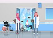 arab doctors discussing in hospital corridor with wheelchair open door to surgery room arabic man sitting operating table modern clinic interior flat full length horizontal vector illustration
