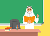 Arab teacher senior man in traditional dress standing with open book at the blackboard in classroom. School class interior. Traditional education concept. Vector cartoon illustration.