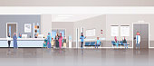 arabic patients in traditional clothes standing line queue at hospital reception desk waiting hall doctors consultation healthcare concept clinic interior full length horizontal flat vector illustrati
