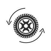 Automobile wheel changing glyph icon. Vector silhouette. Car tire with circle arrow