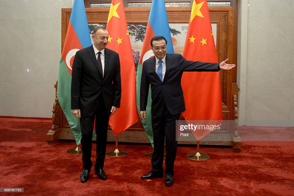 Azerbaijan President Ilham Aliyev (L) is welcomed by Chinese Premier Li Keqiang before their meeting at the Great Hall of the People in Beijing, China on December 10, 2015. Ilham Aliyev is on a visit to China from December 8 to 11