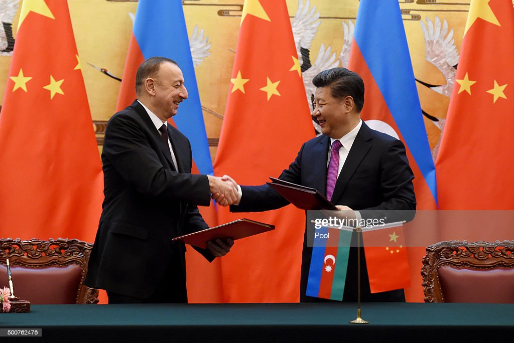Azerbaijan President Ilham Aliyev (L) is welcomed by Chinese President Xi Jinping before their meeting at the Great Hall of the People in Beijing, China on December 10, 2015. Ilham Aliyev is on a visit to China from December 8 to 11