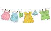 Baby clothing hang on the clothesline. Things are dried on clothespins after washing. Vector illustration.