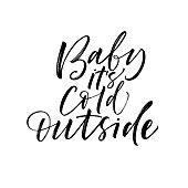 Baby it's cold outside phrase. Greeting card. Ink illustration. Modern brush calligraphy. Isolated on white background.