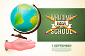 Back to school banner template, with cartoon hand catching globe, on chalkboard background. Vector illustration.