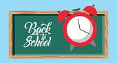 back to school text blackboard and clock vector illustration