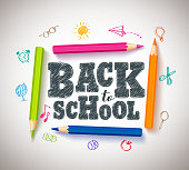Back to school vector typography banner design with colorful crayons and coloring pens in a white paper background. Vector illustration.