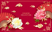 Oriental background with light yellow and pink peonies flowers, decorative golden chinese clouds and fans.