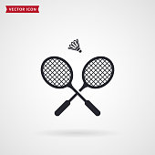 Badminton rackets and shuttlecock. Vector icon isolated on white background. Sport equipment theme.