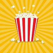 Striped red and white bag of popcorn. Vector illustration in flat style